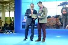 Alexander Romanov is being handed in the award by Sergey Shoygu
