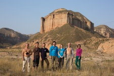 "Members of the expedition next to the ""castle-like hill of red sandstone"", visited by V.A. Obruchev. Near Lanzhou"