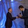 Vladimir Putin presents the award to Konstantin Bogdanov